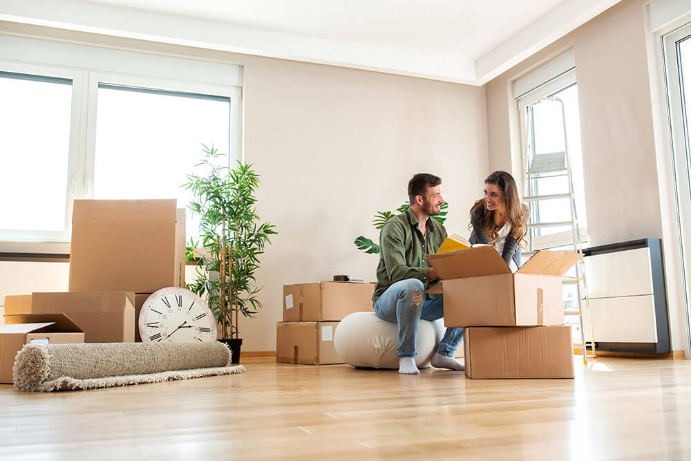 Young couple moving into loft apartment for rent