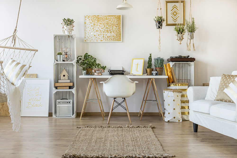 Cute, feminine desk setup in loft style apartment