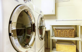 Close up of washer and dryer and shelves with organization in laundry room