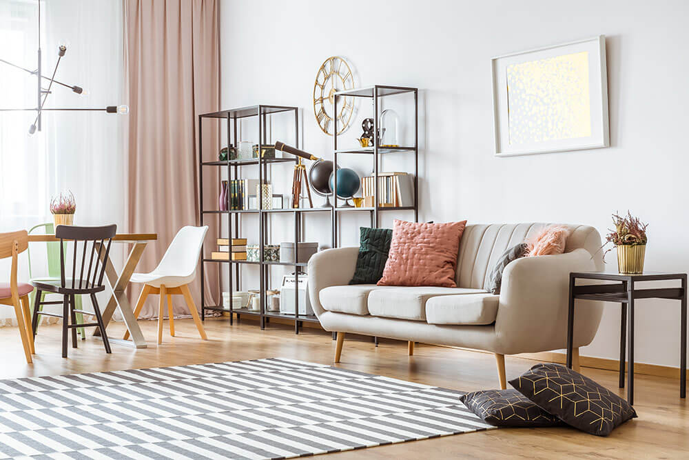 Open living room space with neutral colors, shelf in background