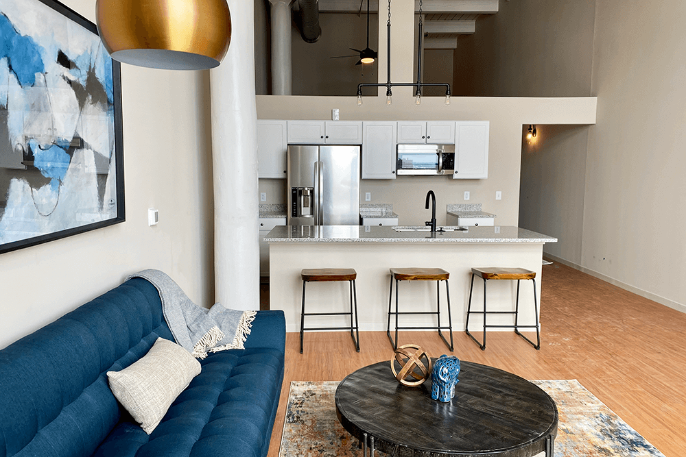 Living room and kitchen area in loft apartments in St. Joseph
