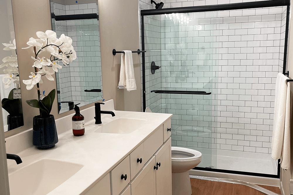 Bathroom vanity and shower in American Electric Loft apartments in St. Joe, MO