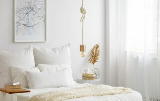 Close up of clean, white, minimalist bedroom